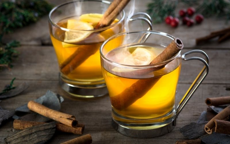 2 Hot Toddy cocktails with cinnamon sticks
