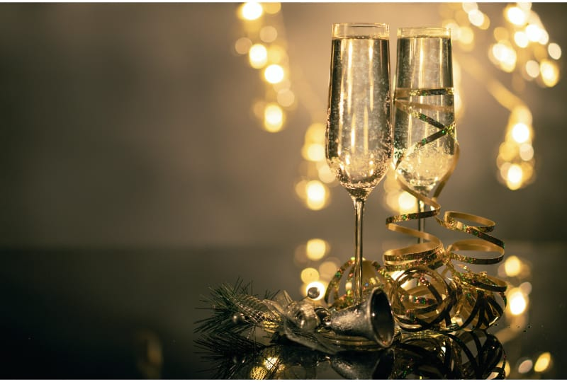 2 glasses of Champagne covered in festive decoration