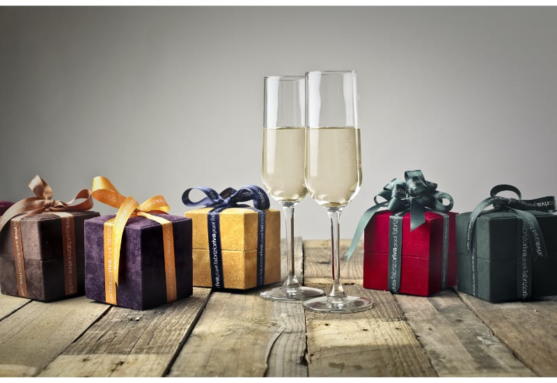 2 glasses of Champagne surrounded by presents