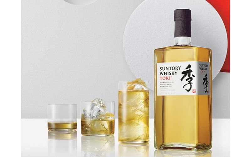 3 glasses and a bottle of Japanese Whisky
