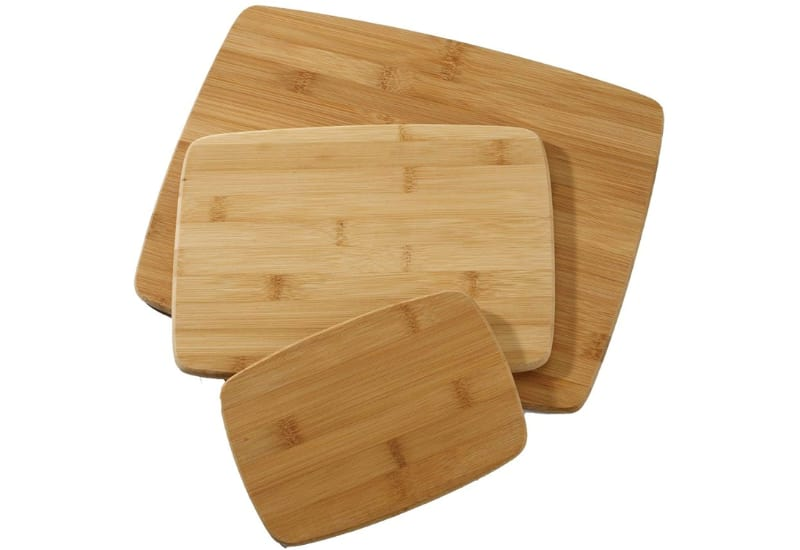 Cutting board with vegetables on the side