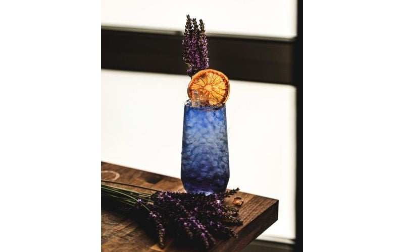 A glass of Lavender Gin Swizzle