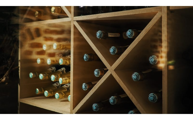 Wines stored on a wooden shelf