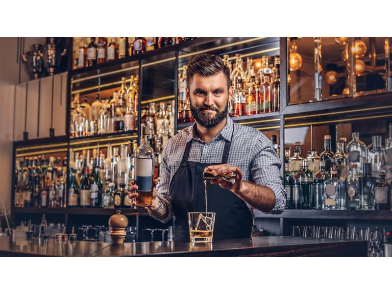 a bartender smiling in a bar