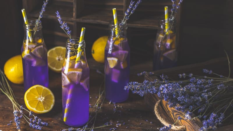 4 bottles of energized purple rain with lemon and straws