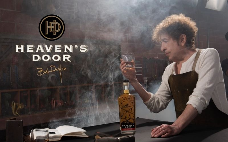 Bob Dylan holding a glass of Heaven's Door whiskey - Image by rollingstone.com