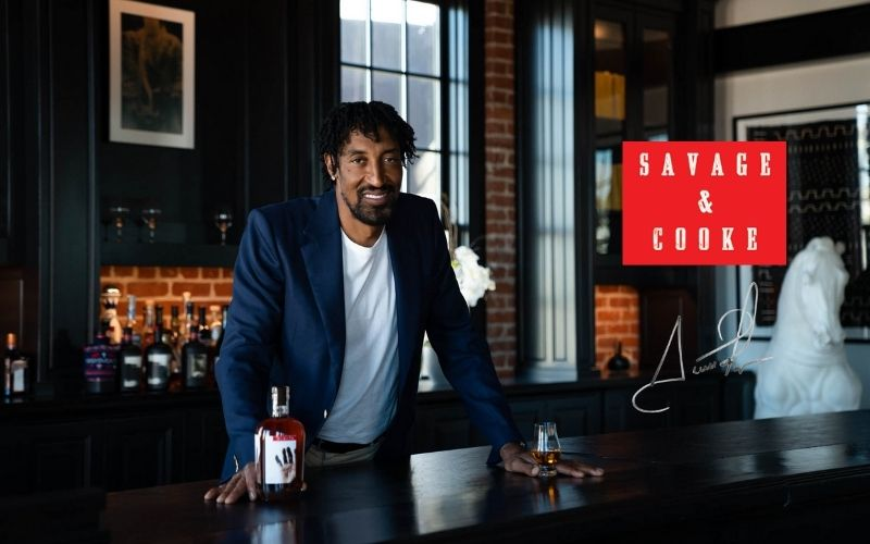 Pippen posing with DIGITS Bourbon by a table - Image by foodandwine.com