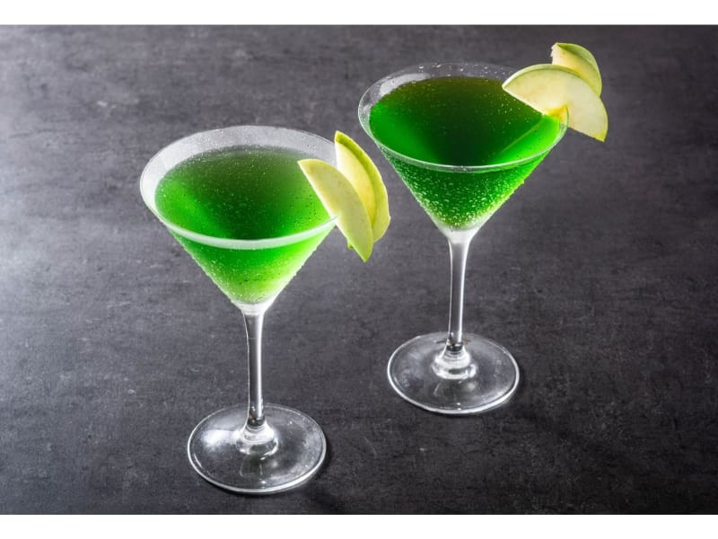 Two glasses of Appletini mocktail with a lime garnish
