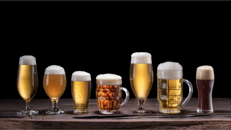 7 different Glasses filled with beer