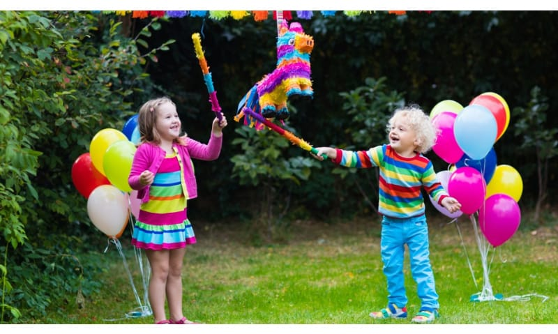 Kids playing with piñata