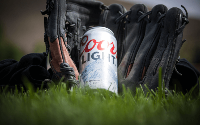A can of Coors Light Beer with baseball mitts