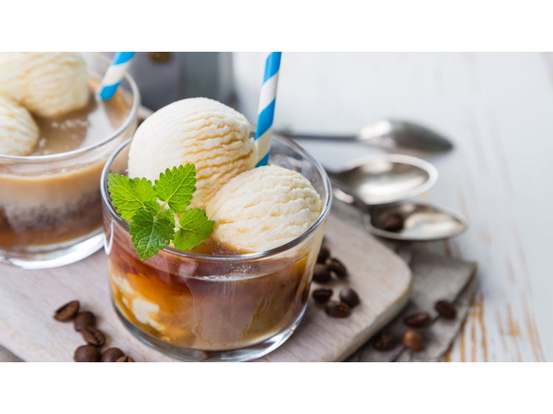A glass of Bailey's coffee float with beans and vanilla ice cream