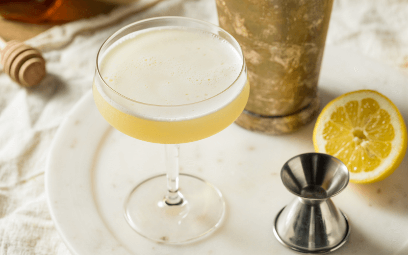 A glass of bee's knees cocktail