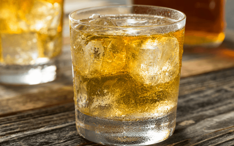 A glass of scotch and soda cocktail