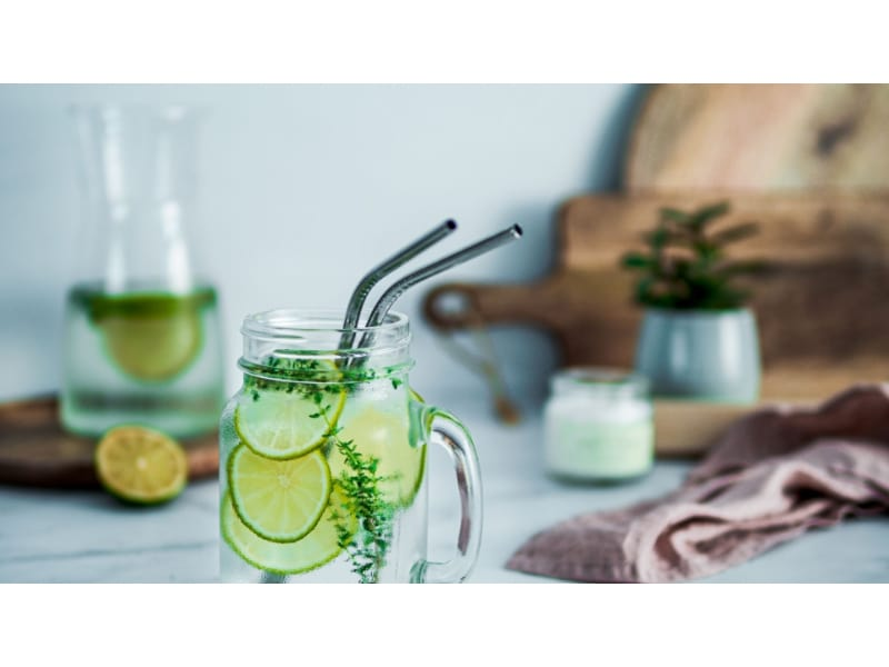 Metal straws used in cold water infused with lemon