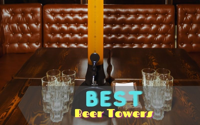 Beer tower and glasses on a wooden table