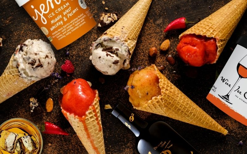 Boozy Ice cream with wine bottle and a glass of bourbon on the table