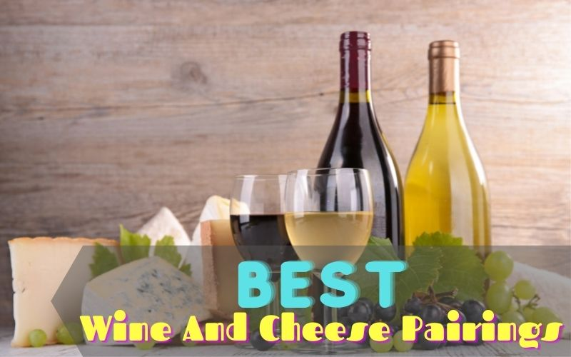 Bottles and glasses of wines beside cheeses