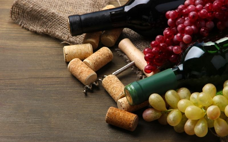 Bottles of Wine, Grapes, and Corks