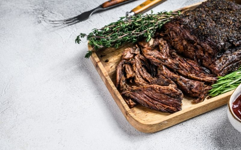 Brisket BBQ Beef Meat Sliced on a Wooden Tray