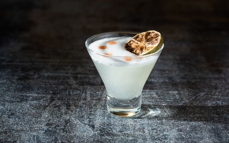 Cocktail with dehydrated lime as garnish