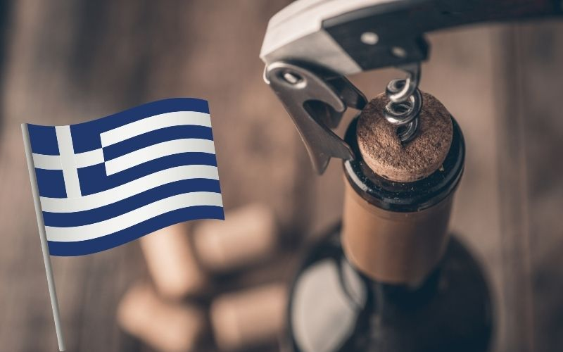 Corkscrew and bottle of wine with Greece's flag