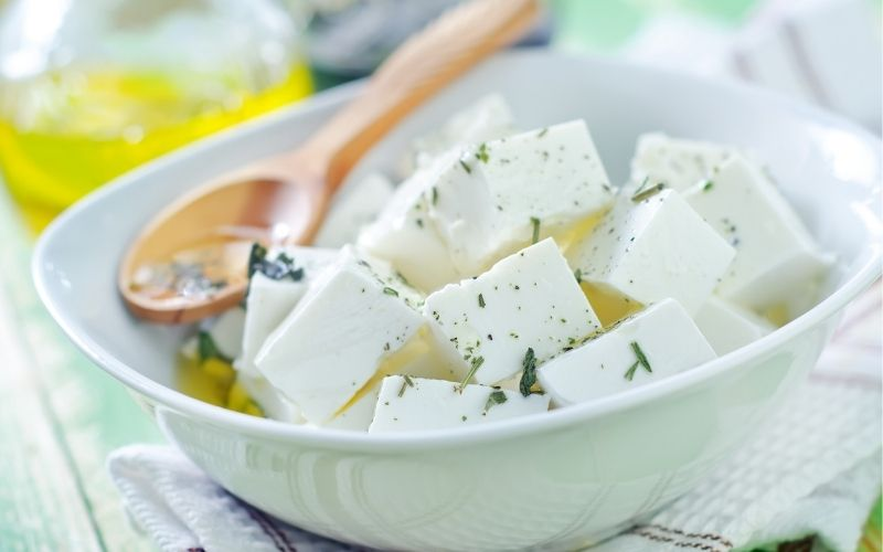 Cubed feta cheese in bowl