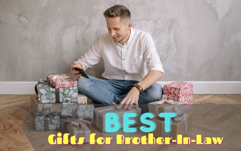 Man checking his gifts while sitting on the floor