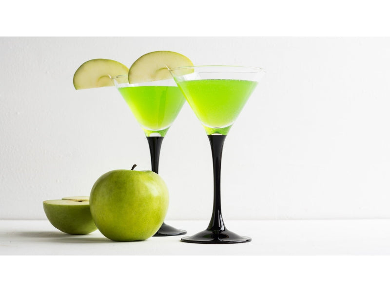 Glasses of Green Dublin Apple cocktail with natural apple