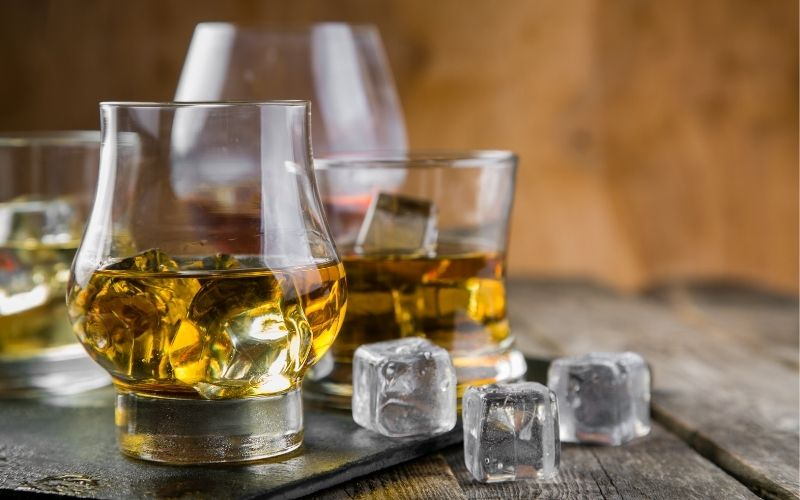 Glasses of bourbon with ice cubes