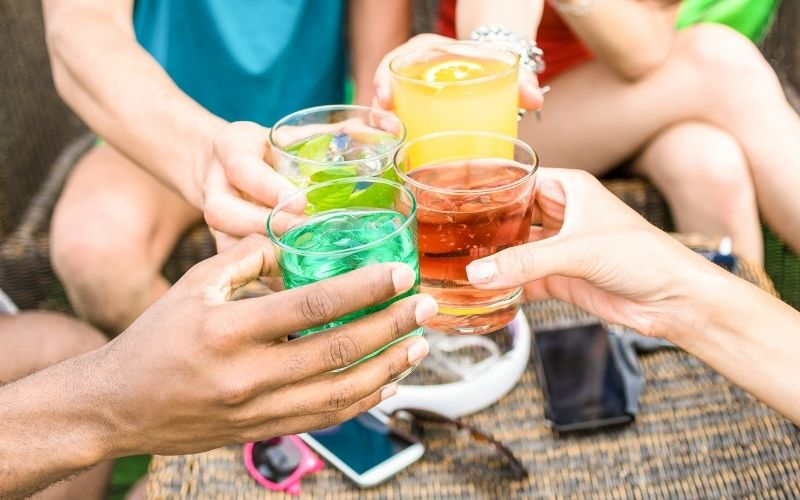 Group of Friends Drinking Summer Cocktails