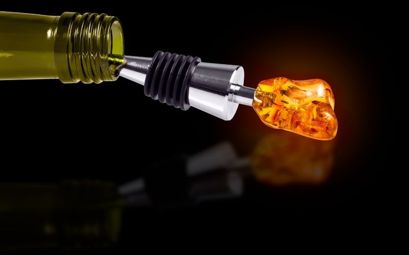 Bottle of Wine with a Stopper from Amber isolated on