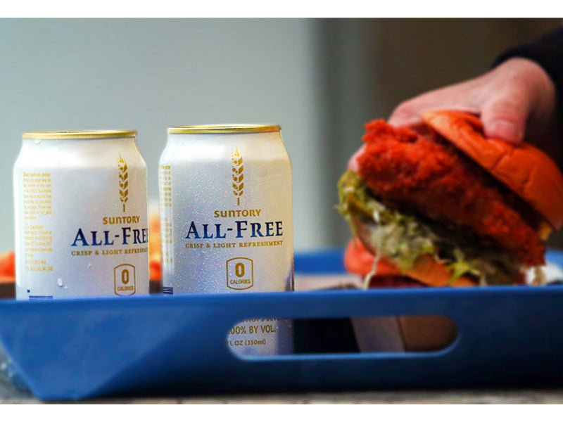 Suntory All-Free with man holding a burger