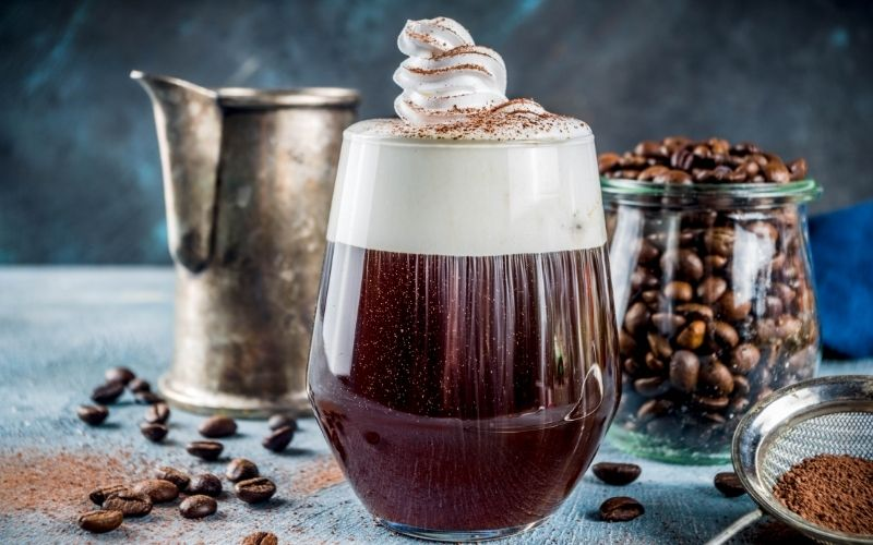 Irish coffee cocktail garnished with whipped cream