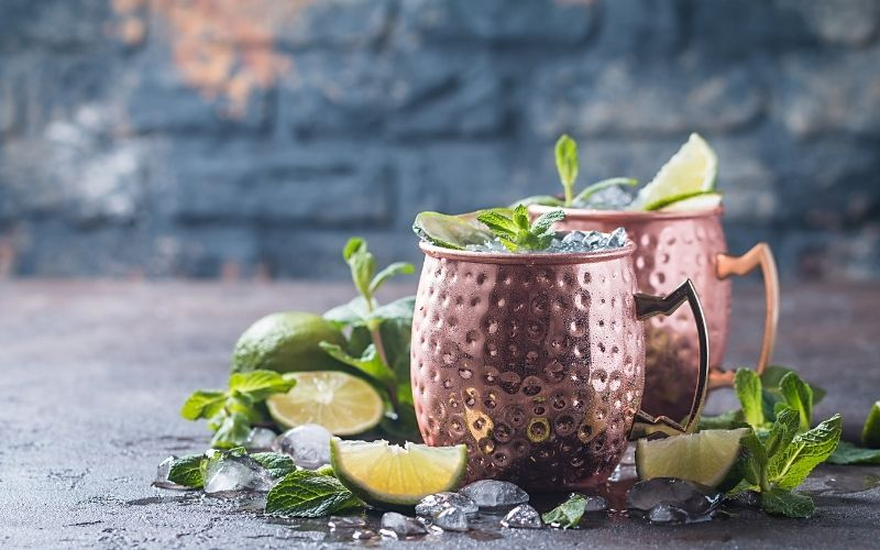 Moscow mule cocktail garnished with fresh herbs