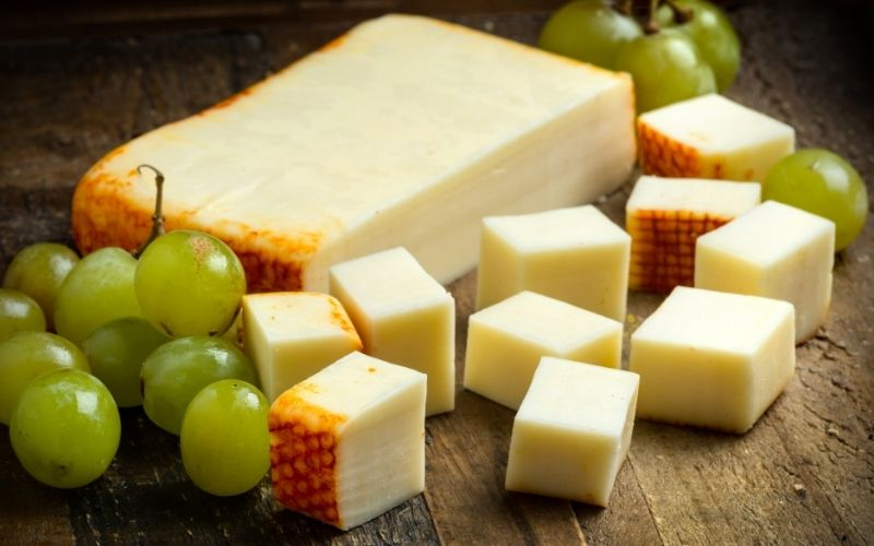 Muenster Cheese with grapes