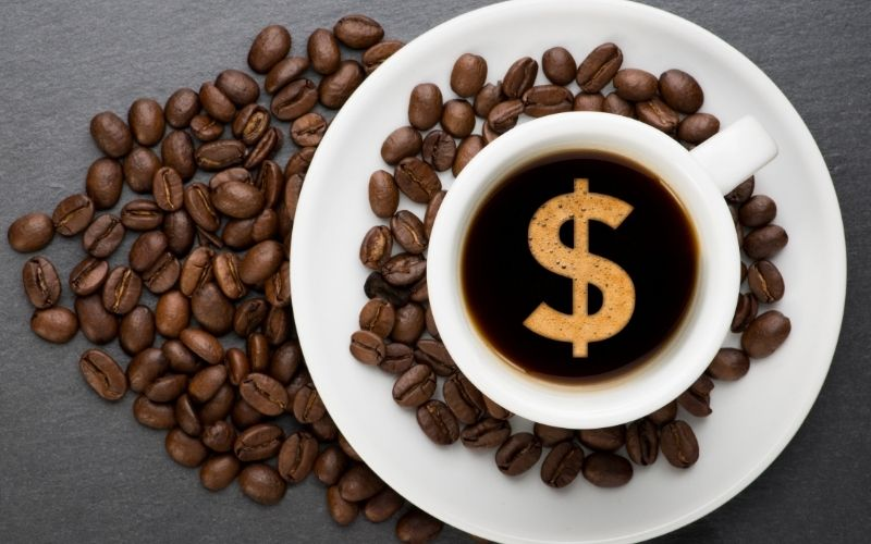 Coffee beans and dollar-sign on coffee
