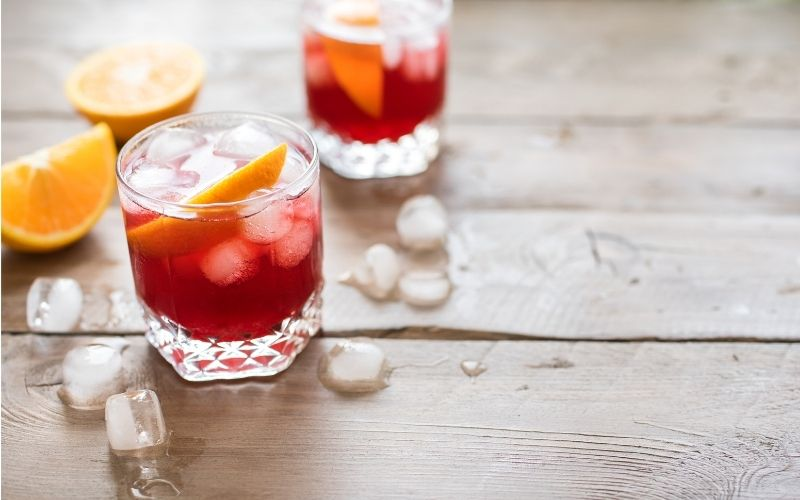 Negroni Sbagliato cocktails with ice cubes and orange slices