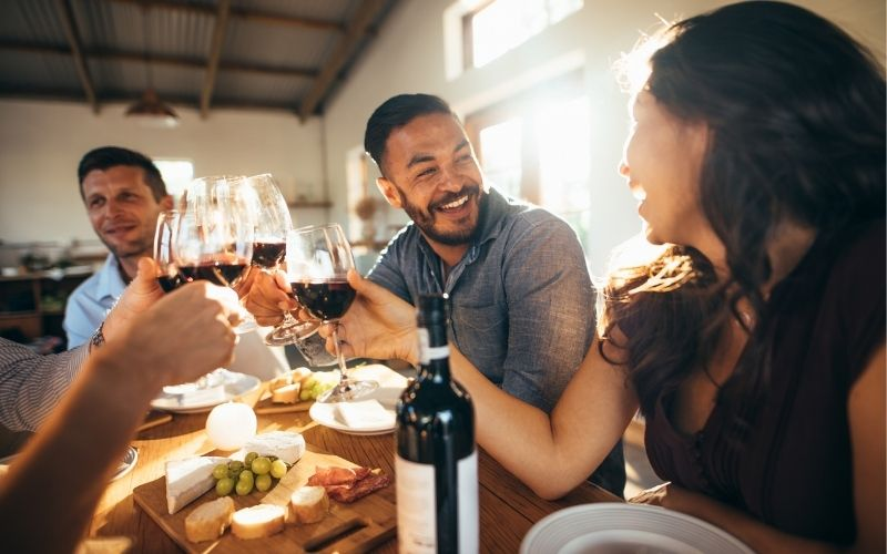 People celebrating a wine tasting party