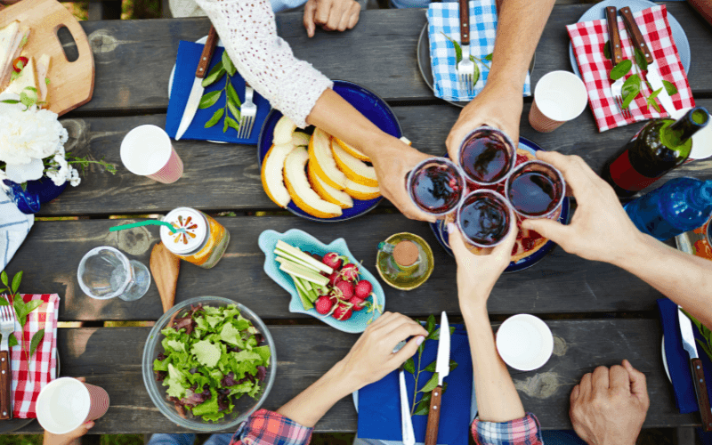 People toasting at a picnic