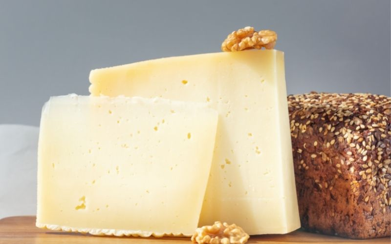 Pieces of Asiago Cheese, Walnut, and Bread