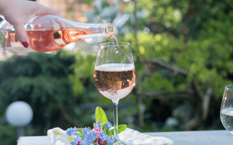 Pouring a glass of cold rose wine