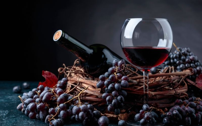 Red wine and grapes in a basket