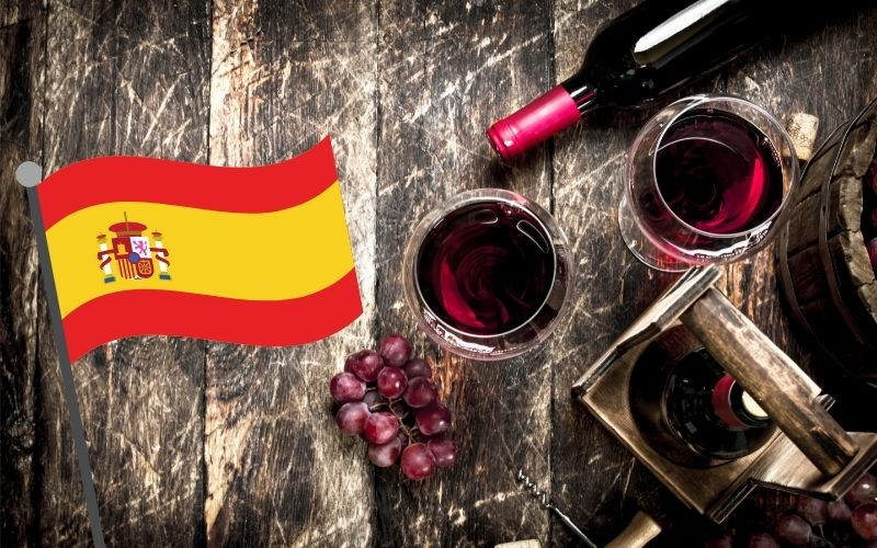 Red wine with glasses with grapes with Spain's flag