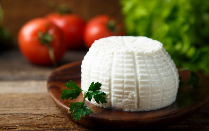 Ricotta cheese on wooden plate