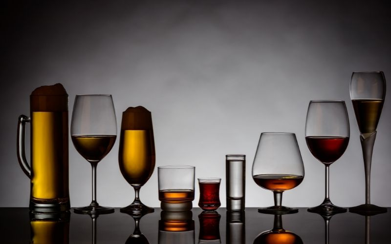 Glasses of different alcoholic beverages