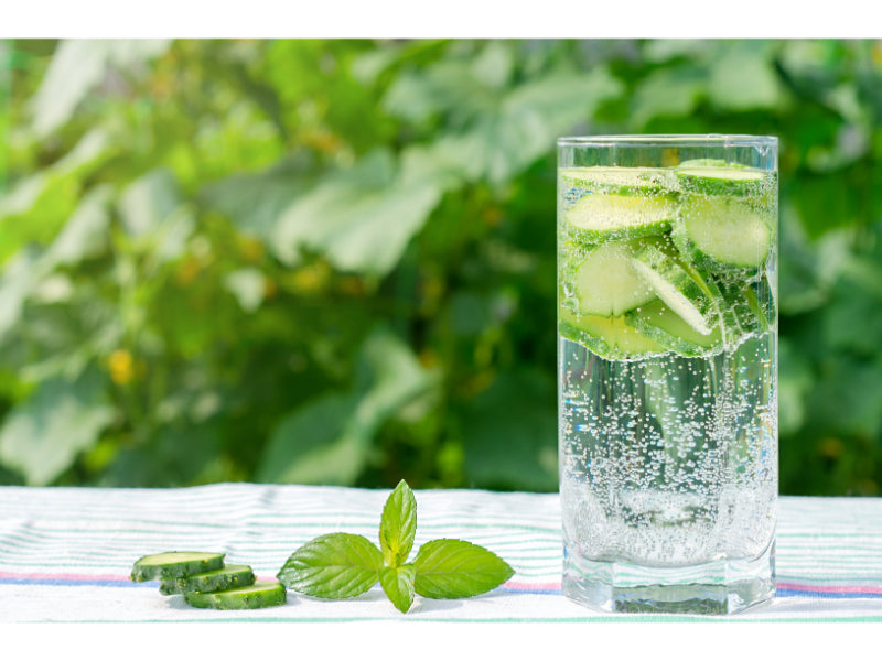 Sliced cucumbers in a glass of sparkling water
