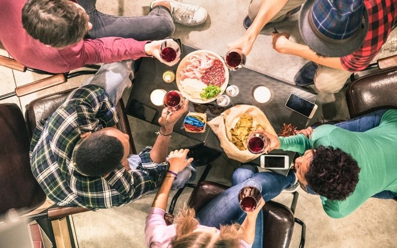Top view of friends drinking and eating