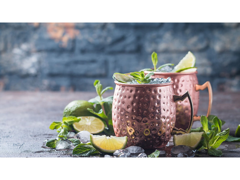 Two copper mugs of Irish Mule with limes and mint