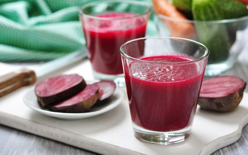 Two glasses of beetroot juice on a tray